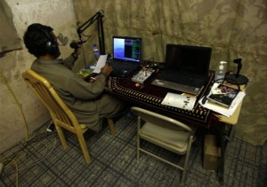 DJ-Ashiqullah-works-at-the-Garmsir-radio-station-in-Helmand-province-July-7-2009.-The-DJs-of-Radio-Garmsir-in-Afghanistans-lower-Helmand-River-valley-knew-their-station-had-touched-a-nerve-when-the-letters-started-pouring-in.-Fi-650x458