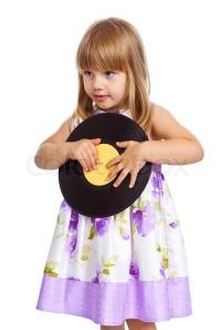 4752643-961029-attractive-little-girl-holding-vinyl-record